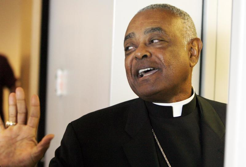 FILE - In this Aug. 26, 2008, file photo, Archbishop Wilton Gregory of Atlanta exits the St. Clair County Courthouse in Belleville, Ill. Gregory apologized Monday, March 31, 2014, for building a $2.2 million mansion for himself, a decision criticized by local Catholics who cited the example of austerity set by the new pope. (AP Photo/ Belleville News-Democrat, Derik Holtmann, File)