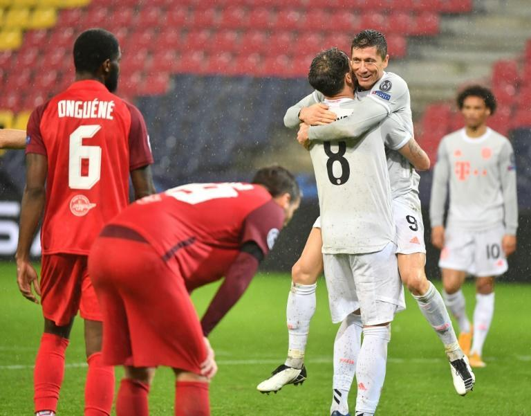 Robert Lewandowski (second from right) celebrates the second of his two Bayern Munich goals in Salzburg on Tuesday