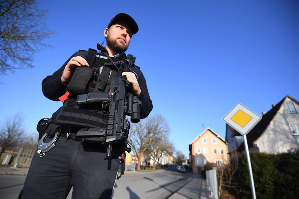 A policeman secures the area close to a house where a shooter, believed to have a personal motive, launched an assault on January 24, 2020 in the town of Rot am See in southwestern Germany. - Six people have been killed and two seriously injured in the shooting, police said. A man with a personal connection to the victims had been arrested, a police spokesman told AFP. (Photo by Marijan Murat / DPA / AFP) / Germany OUT (Photo by MARIJAN MURAT/DPA/AFP via Getty Images)