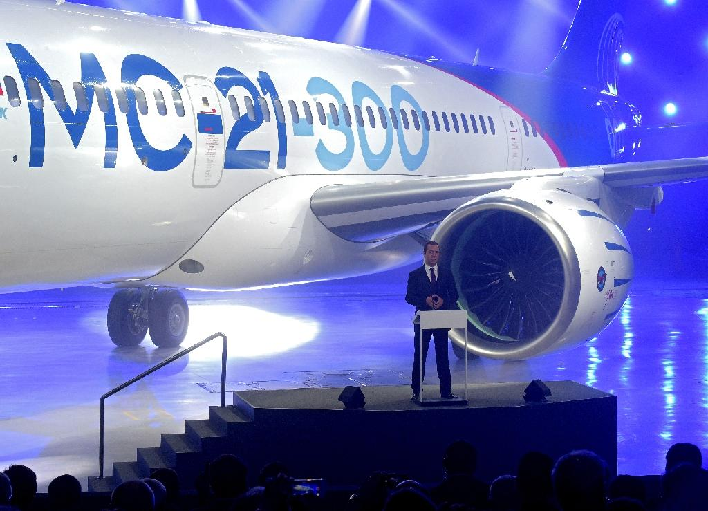 Russian Prime Minister Dmitry Medvedev in front of the new MC-21 medium-haul jet, which has made a successful test flight, during its roll-out ceremony last June (AFP Photo/Alexander Astafyev)