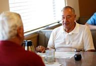 Gerald Poor (R) talks with long time friend Larry Terrell at a cafe in Muncie Indiana, U.S., August 13, 2016. Picture taken August 13, 2016. REUTERS/Chris Bergin