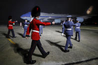 Military personnel march as Air Force One, carrying U.S. President Joe Biden and First Lady Jill Biden arrives at Cornwall Airport Newquay, near Newquay, England, ahead of the G7 summit in Cornwall, Wednesday, June 9, 2021. (Phil Noble/Pool Photo via AP)