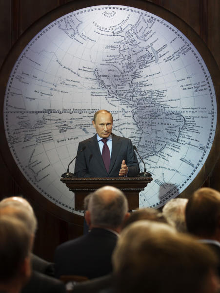 Russian Prime Minister Vladimir Putin speaks at a meeting of the guardian council of the Russian Geographic Society in St. Petersburg, Russia, Tuesday, April 10, 2012. (AP Photo/Dmitry Lovetsky)