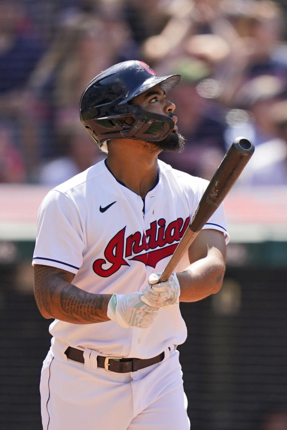 Cleveland Indians' Bobby Bradley watches his sacrifice fly in the eighth inning of a baseball game against the Tampa Bay Rays, Sunday, July 25, 2021, in Cleveland. Indians' Amed Rosario scored on the play. (AP Photo/Tony Dejak)