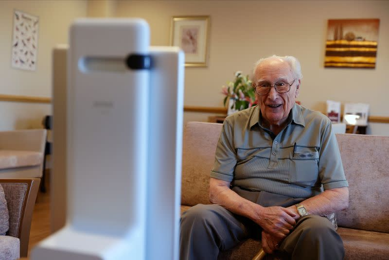 Resident Orchard chats via Facebook Portal to his family at the Foxholes Care Home