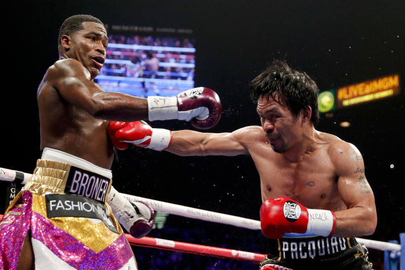 Manny Pacquiao, right, hits Adrien Broner during their WBA welterweight title boxing match Saturday, Jan. 19, 2019, in Las Vegas. (AP Photo/John Locher)
