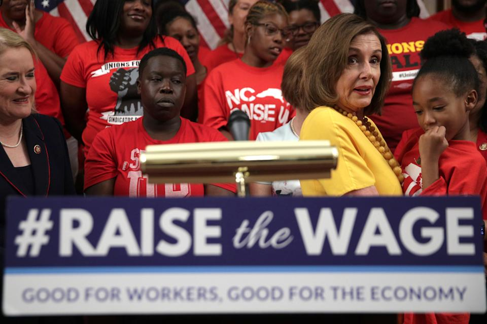 WASHINGTON, DC - JULY 18:  U.S. Speaker of the House Rep. Nancy Pelosi (D-CA) holds up seven-year-old Kassidy Durham of Durham, North Carolina, during a news conference prior to a vote on the Raise the Wage Act July 18, 2019 at the U.S. Capitol in Washington, DC. The legislation would raise the federal minimum wage from $7.25 to $15 by 2025.  (Photo by Alex Wong/Getty Images)