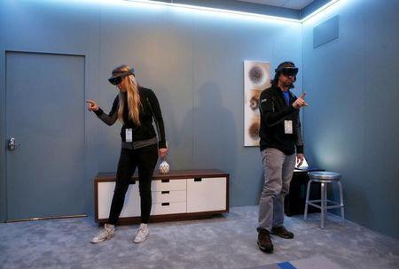 Microsoft employees demonstrate HoloLens during the Microsoft Build 2016 Developers Conference in San Francisco, California March 30, 2016. REUTERS/Beck Diefenbach/Files photo