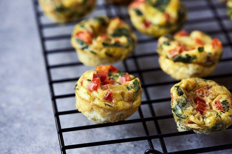 """<p><strong>Breakfast:</strong> <a href=""""http://tasty-yummies.com/mini-frittata-egg-bites/"""" target=""""_blank"""" class=""""ga-track"""" data-ga-category=""""Related"""" data-ga-label=""""http://tasty-yummies.com/mini-frittata-egg-bites/"""" data-ga-action=""""In-Line Links"""">mini frittata egg bites</a> with brown rice<br> <strong>Lunch:</strong> <a href=""""https://www.popsugar.com/fitness/Healthy-Kale-Caesar-Salad-Recipe-34275742"""" class=""""ga-track"""" data-ga-category=""""Related"""" data-ga-label=""""https://www.popsugar.com/fitness/Healthy-Kale-Caesar-Salad-Recipe-34275742"""" data-ga-action=""""In-Line Links"""">kale caesar salad</a> with chicken and couscous<br> <strong>Dinner:</strong> <a href=""""https://www.popsugar.com/fitness/Tomato-Lentil-Soup-Recipe-26245597"""" class=""""ga-track"""" data-ga-category=""""Related"""" data-ga-label=""""https://www.popsugar.com/fitness/Tomato-Lentil-Soup-Recipe-26245597"""" data-ga-action=""""In-Line Links"""">tomato lentil soup</a> and a side salad with arugula, quinoa, and veggies, tossed with olive oil and vinegar<br> <strong>Snack:</strong> assorted fruit</p>"""