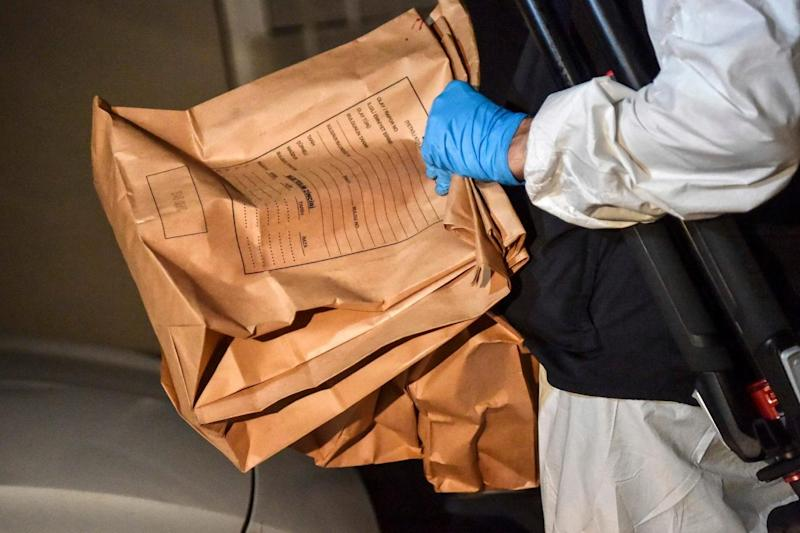 A Turkish forensic police officer carries evidence packs while he leaves the Saudi consulate (AFP/Getty Images)