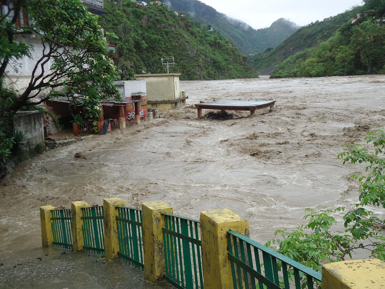 RUDRAPRAYAG, INDIA - JUNE 16: Several houses on the banks of Alaknanda River have fallen prey to the rise in water level post heavy rainfall on June 16, 2013 in Rudraprayag, India. 11 people died, nearly 50 were missing and thousands stranded in landslides set off by the incessant downpour in Uttarakhand. (Photo by Kuldeep Rana/Hindustan Times via Getty Images)