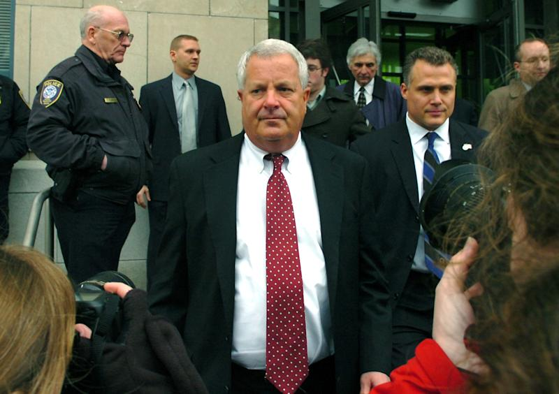 """FILE - In this Feb. 12, 2009 file photo, Michael Conahan, center, leaves the federal courthouse in Scranton, Pa. The film """"Kids for Cash"""" set to open explores the scandal that entangled thousands of children in Pennsylvania's juvenile court system and sent two former judges to prison. Mark Ciavarella is serving a 28-year sentence and fellow ex-judge Conahan is serving 17 years for taking $2.6 million from companies looking to build and fill a youth detention center for Luzerne County. (AP Photo/David Kidwell, File)"""