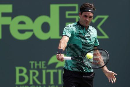 Apr 2, 2017; Key Biscayne, FL, USA; Roger Federer of Switzerland hits a backhand against Rafael Nadal of Spain (not pictured) in the men's singles championship of the 2017 Miami Open at Crandon Park Tennis Center. Mandatory Credit: Geoff Burke-USA TODAY Sports
