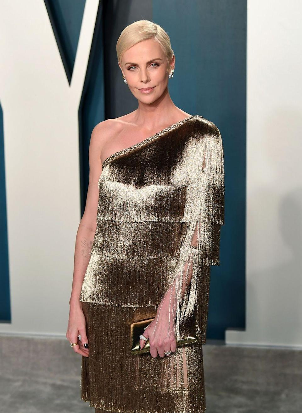 <p><b>Hair </b></p><p>Theron's fashion and hair choices throughout the years have made her a standout in Hollywood, often being best dressed on the red carpet. </p>