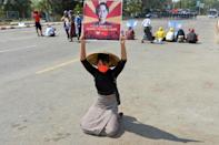 A protester holds up a sign calling for the release of detained Myanmar civilian leader Aung San Suu Kyi during a demonstration against the military coup in Naypyidaw