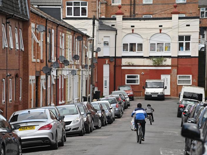 Children cycle in North Evington, one of the worst-hit areas of Leicester: AFP via Getty Images