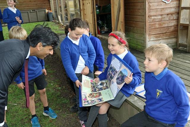 Rishi Sunak with pupils from the Pickhill Church of England Primary School eco team near Thirsk, North Yorkshire