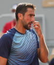 Croatia's Marin Cilic reacts after losing a point to Switzerland's Roger Federer during their second round match on day 5, of the French Open tennis tournament at Roland Garros in Paris, France, Thursday, June 3, 2021. (AP Photo/Michel Euler)