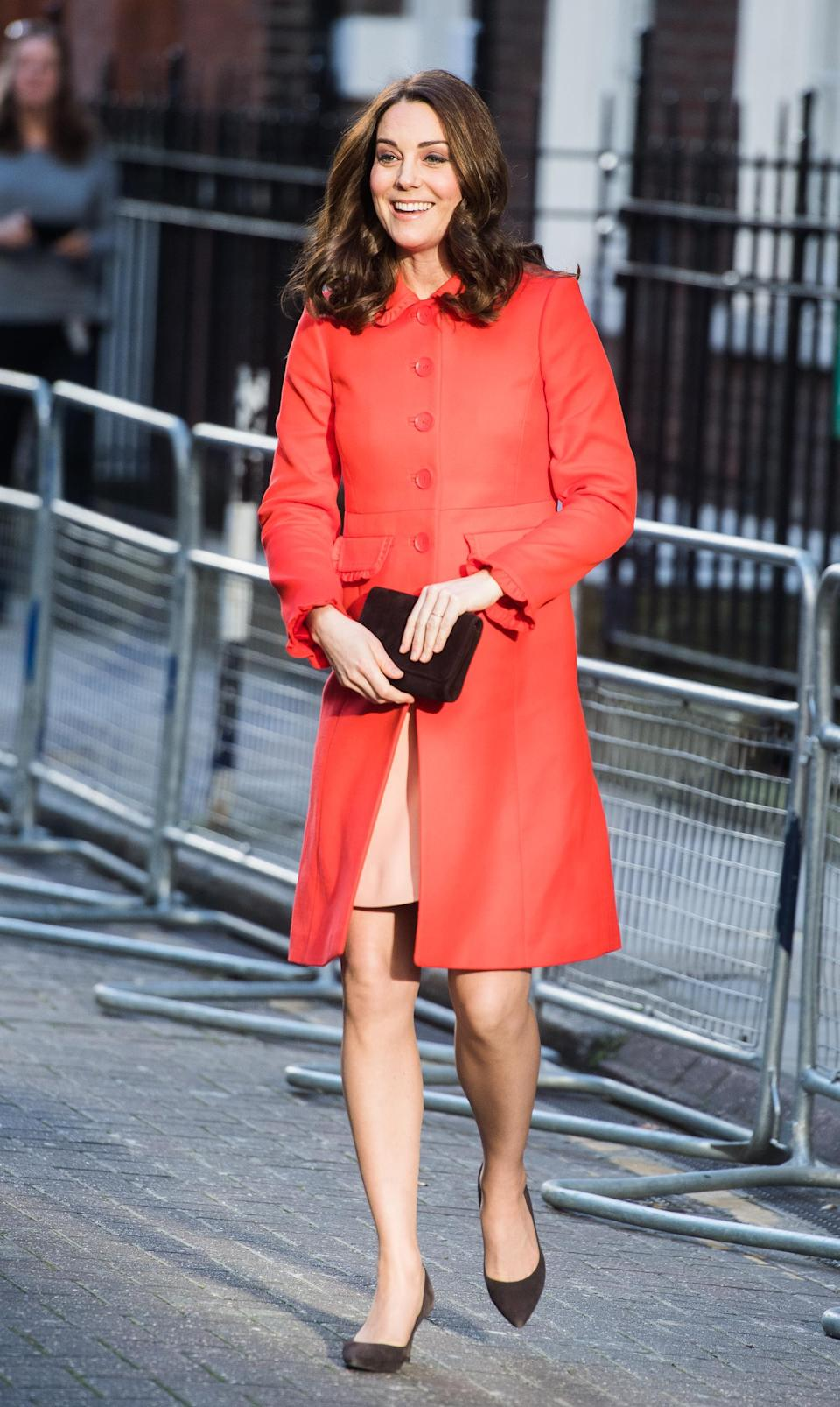 <p><strong>The occassion:</strong> A visit to Great Ormond Street Hospital in London. <br><strong>The look:</strong> A bright red coat by Boden with Annoushka Baroque drop earrings.<br>[Photo: Getty] </p>