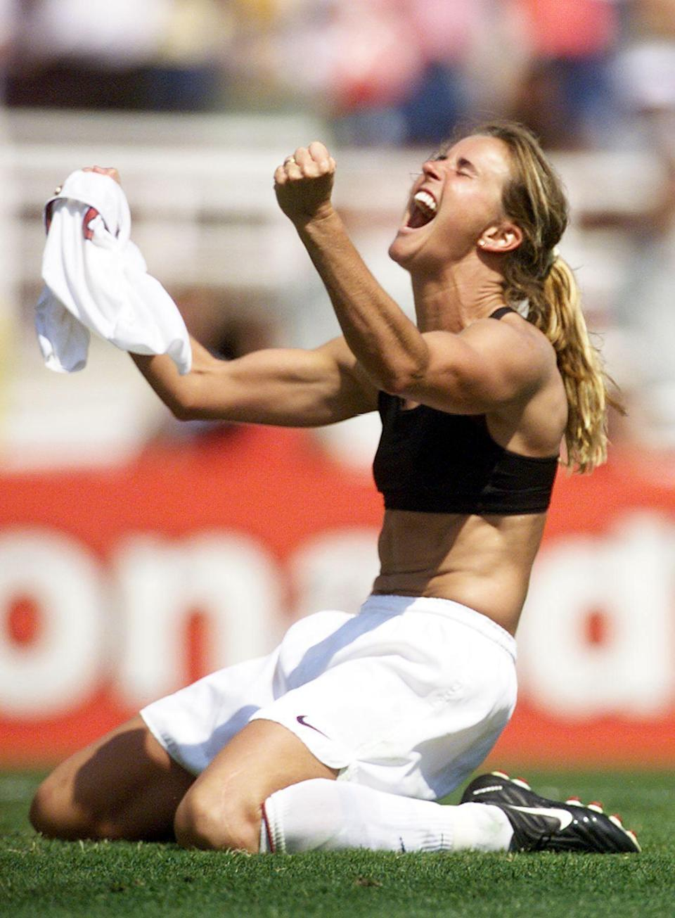 """<p>Some would count a black Nike sports bra as an iconic piece of clothing after Chastain kicked the winning penalty shot during the 1999 Women's World Cup against China and took off her jersey, twirling it in the air in triumph. The photo would go on to cover Jane Gottesman's book <b>Game Face: What Does a Female Athlete Look Like?</b> and the <a href=""""https://www.nytimes.com/2019/07/05/sports/soccer/brandi-chastain-womens-world-cup-image.html"""" class=""""link rapid-noclick-resp"""" rel=""""nofollow noopener"""" target=""""_blank"""" data-ylk=""""slk:sports bra is now framed in Chastain's home"""">sports bra is now framed in Chastain's home</a>. (She was even offered $500,000 for it shortly after the match.)</p>"""