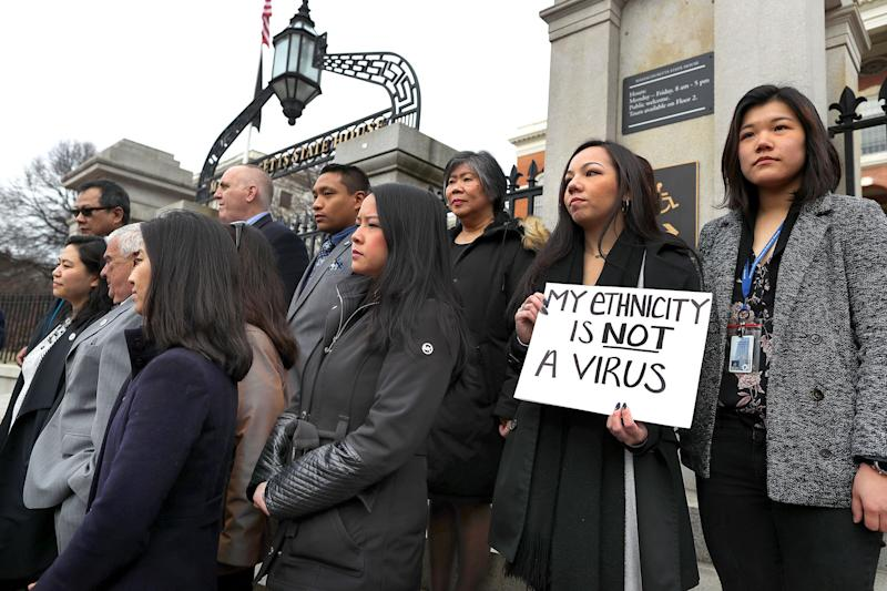 Members of the Asian American Commission, on the steps of the Massachusetts State House in Boston, condemn racism towards their community on March 12, 2020. (Photo: Boston Globe/Getty Images)