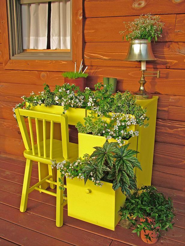"""<div class=""""caption-credit"""">Photo by: Nancy Ondra</div><div class=""""caption-title"""">Office Space</div>Turn an old desk into a charming container by tucking small bushy and trailing plants into the partly opened drawers. Complete the effect by popping plants into desk accessories, such as a pencil holder, an old telephone or a small desk lamp."""