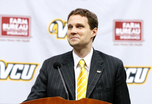 New VCU college basketball coach Will Wade smiles at a news conference Wednesday, April 8, 2015, in Richmond, Va. (AP Photo/Richmond Times-Dispatch, Mark Gormus)