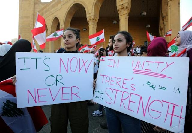 Lebanese protesters take to the streets during demonstrations to demand better living conditions and the ouster of a cast of politicians who have monopolised power and influence for decades (AFP Photo/Anwar AMRO)