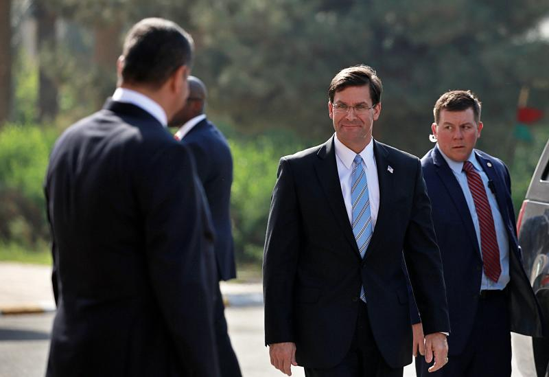 Iraqi Defense Minister Najah al-Shammari, left, prepares to welcome the visiting U.S. Defense Secretary Mark Esper, center right, at the Ministry of Defense, Baghdad, Iraq, Wednesday, Oct. 23, 2019. Esper has arrived in Baghdad on a visit aimed at working out details about the future of American troops that are withdrawing from Syria to neighboring Iraq. (AP Photo/Hadi Mizban)