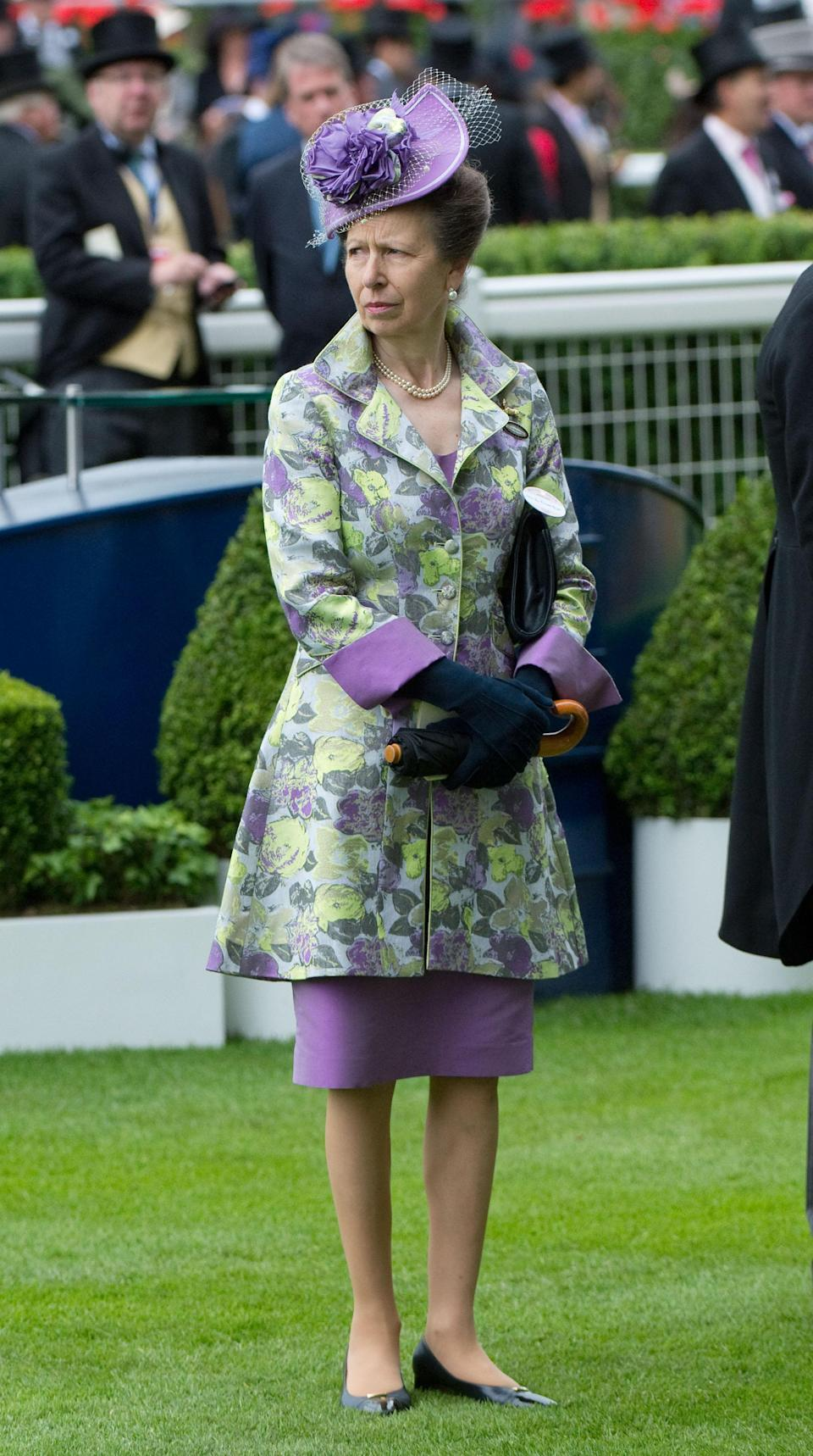 <p>Princess Anne went for a bold print and bold colour duo in 2012, wearing a risky green and purple dress-coat. <em>[Photo: Getty]</em> </p>