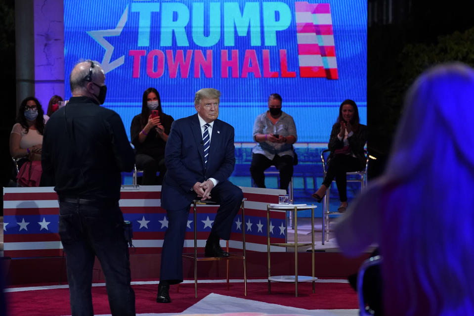 President Donald Trump sits during a break in an NBC News Town Hall, at Perez Art Museum Miami, Thursday, Oct. 15, 2020, in Miami. (AP Photo/Evan Vucci)