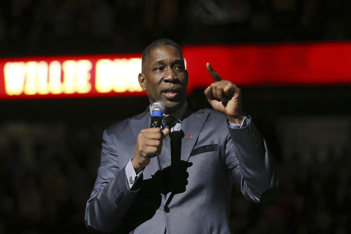 Former Minnesota great Willis Burton speaks after his No. 34 jersey was retired at Williams Arena during an NCAA college basketball game against Michigan State, Sunday, Jan. 26, 2020, in Minneapolis. (AP Photo/Stacy Bengs)