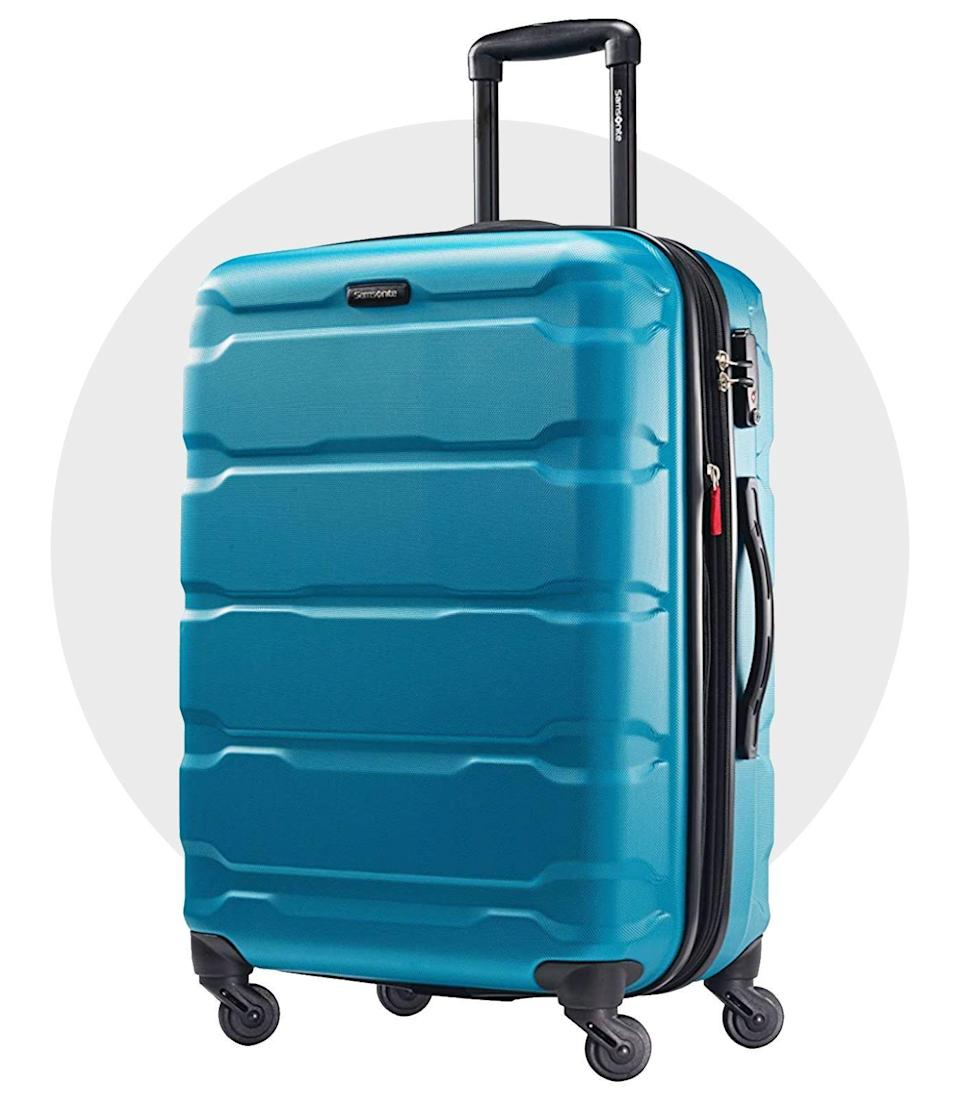 """<p><strong>Samsonite</strong></p><p>amazon.com</p><p><strong>$105.99</strong></p><p><a href=""""https://www.amazon.com/dp/B013WFNY20?tag=syn-yahoo-20&ascsubtag=%5Bartid%7C2139.g.36452075%5Bsrc%7Cyahoo-us"""" rel=""""nofollow noopener"""" target=""""_blank"""" data-ylk=""""slk:BUY IT HERE"""" class=""""link rapid-noclick-resp"""">BUY IT HERE</a></p><p>Samsonite's known for its reliability, and the Omni PC line has to be one of the brand's most dependable to date. Made from super-light polycarbonate, the style comes in at a little over nine pounds and is scratch-resistant, so each time you pick up ol' reliable here it'll be looking good as new. </p>"""