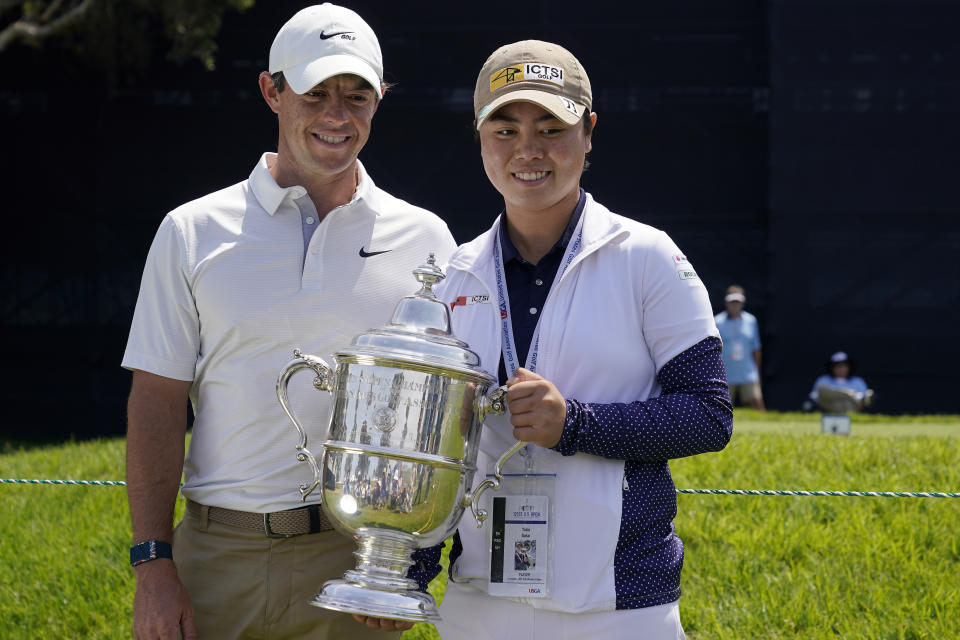 U.S. Women's Open golf winner Yuka Saso, of the Philippines, poses with her champions trophy with Rory McIlroy, of Northern Ireland, during a practice round of the U.S. Open Golf Championship, Tuesday, June 15, 2021, at Torrey Pines Golf Course in San Diego. (AP Photo/Gregory Bull)