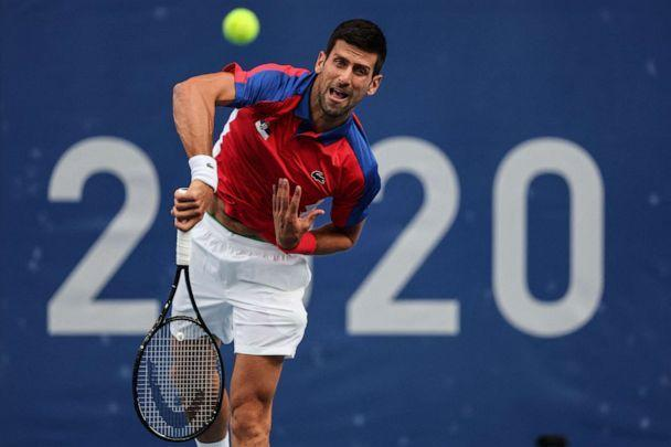 PHOTO: Serbia's Novak Djokovic serves to Germany's Jan-Lennard Struff during their Tokyo 2020 Olympic Games men's singles second round tennis match at the Ariake Tennis Park in Tokyo on July 26, 2021. (Giuseppe Cacace/AFP via Getty Images)