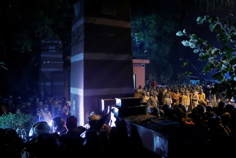 Police in riot gear stand guard inside the Jawaharlal Nehru University (JNU) after clashes between students in New Delhi