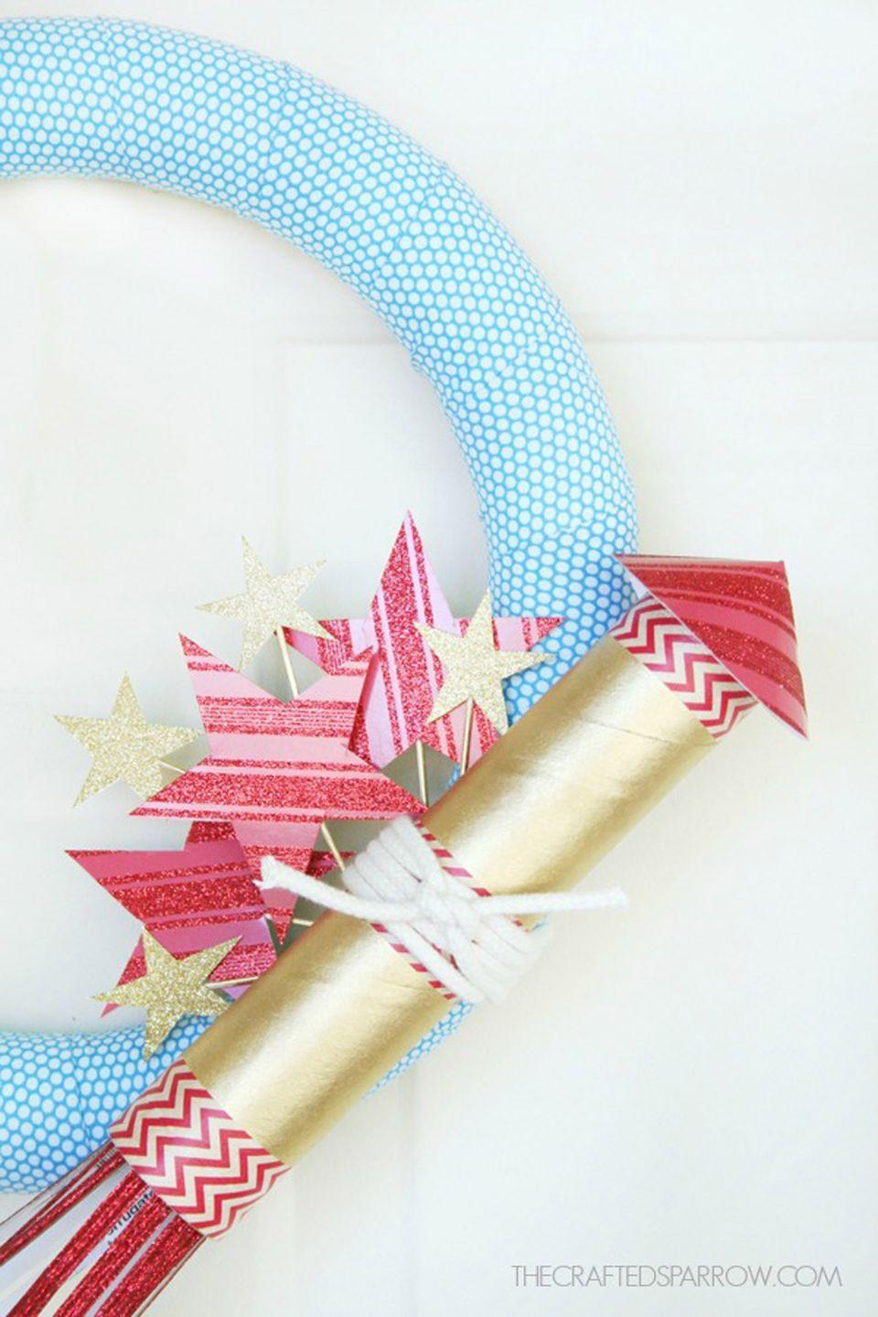 """<p>Blogger Rebecca writes her number one tip is to pin—not glue—the fabric on this foam wreath so it can be used for different holidays.</p><p><strong>Get the tutorial at <a href=""""http://www.thecraftedsparrow.com/2014/06/4th-july-wreath.html"""" rel=""""nofollow noopener"""" target=""""_blank"""" data-ylk=""""slk:Crafted Sparrow"""" class=""""link rapid-noclick-resp"""">Crafted Sparrow</a>.</strong></p><p><a class=""""link rapid-noclick-resp"""" href=""""https://www.amazon.com/Rust-Oleum-245221-Universal-Surface-Metallic/dp/B0016HLAH8/ref=sr_1_1?tag=syn-yahoo-20&ascsubtag=%5Bartid%7C10050.g.4464%5Bsrc%7Cyahoo-us"""" rel=""""nofollow noopener"""" target=""""_blank"""" data-ylk=""""slk:SHOP GOLD SPRAY PAINT"""">SHOP GOLD SPRAY PAINT</a></p>"""