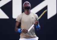 United States' Frances Tiafoe reacts during his second round match against Serbia's Novak Djokovic at the Australian Open tennis championship in Melbourne, Australia, Wednesday, Feb. 10, 2021.(AP Photo/Rick Rycroft)