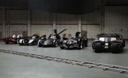 Batmobiles from the classic 1966 TV show (left) up through 2008's  <em>The Dark Knight</em> (Photo: Warner Bros.)