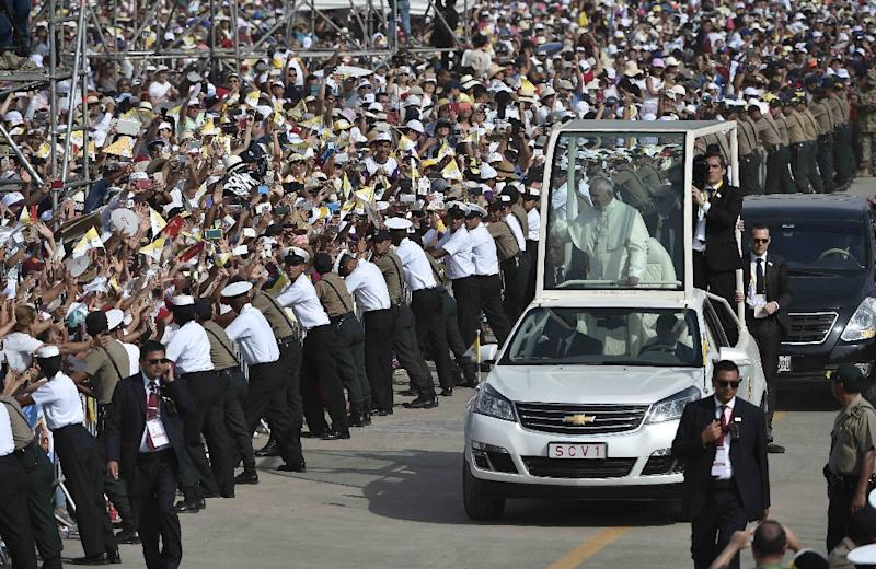 Pope Francis arriving in the popemobile to celebrate mass at the Las Palmas air base in Lima on January 21, 2018, in a handout picture released by the Vatican press office Osservatore Romano (AFP Photo/HO)