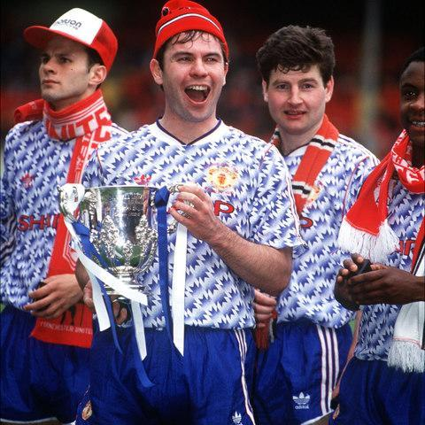 Brian McClair with the 1992 League Cup - Credit:  Bob Thomas