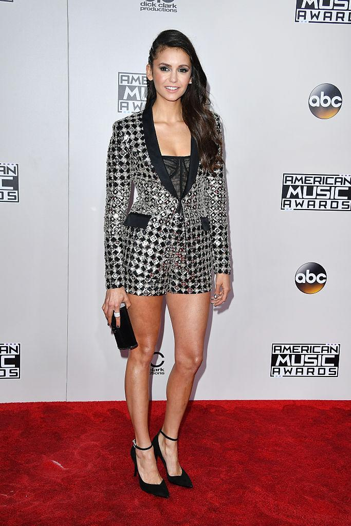 <p>Nina Dobrev made the pantsuit sexy by showing off her legs in short shorts. <em>(Photo: Getty Images)</em> </p>