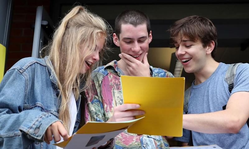 Madeline Ashman, Thomas Wroy and William Sharp after getting A-level results at Peter Symonds College in Winchester, Hampshire.