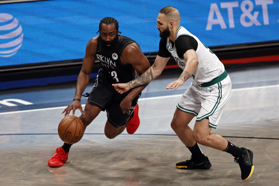 Brooklyn Nets guard James Harden drives to the basket past Boston Celtics guard Evan Fournier in the second half of Game 5 during an NBA basketball first-round playoff series, Tuesday, June 1, 2021, in New York. (AP Photo/Adam Hunger)