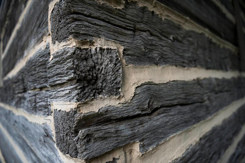 A detail of weathered wood on corner of a barn on The William Faulkner Houseproperty.