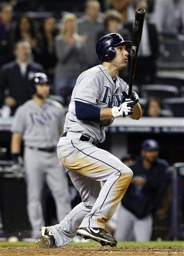 Tampa Bay Rays' Matt Joyce twists his left ankle as he watches his ninth-inning, three-run home run against the New York Yankees in their baseball game at Yankee Stadium in New York, Wednesday, May 9, 2012. The Rays won 4-1. (AP Photo/Kathy Willens)