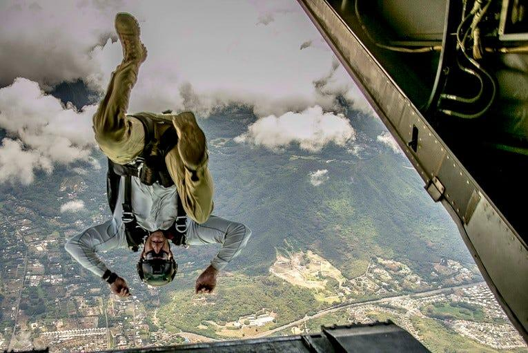 A service member jumps out of a Marine Corps MV-22B Osprey during parachute training at Marine Corps Training Area Bellows, Hawaii, Aug. 13, 2019.