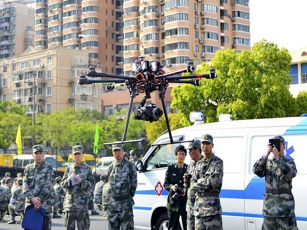 A team of Chinese military flying drones. (Photo Credit - Reuters)