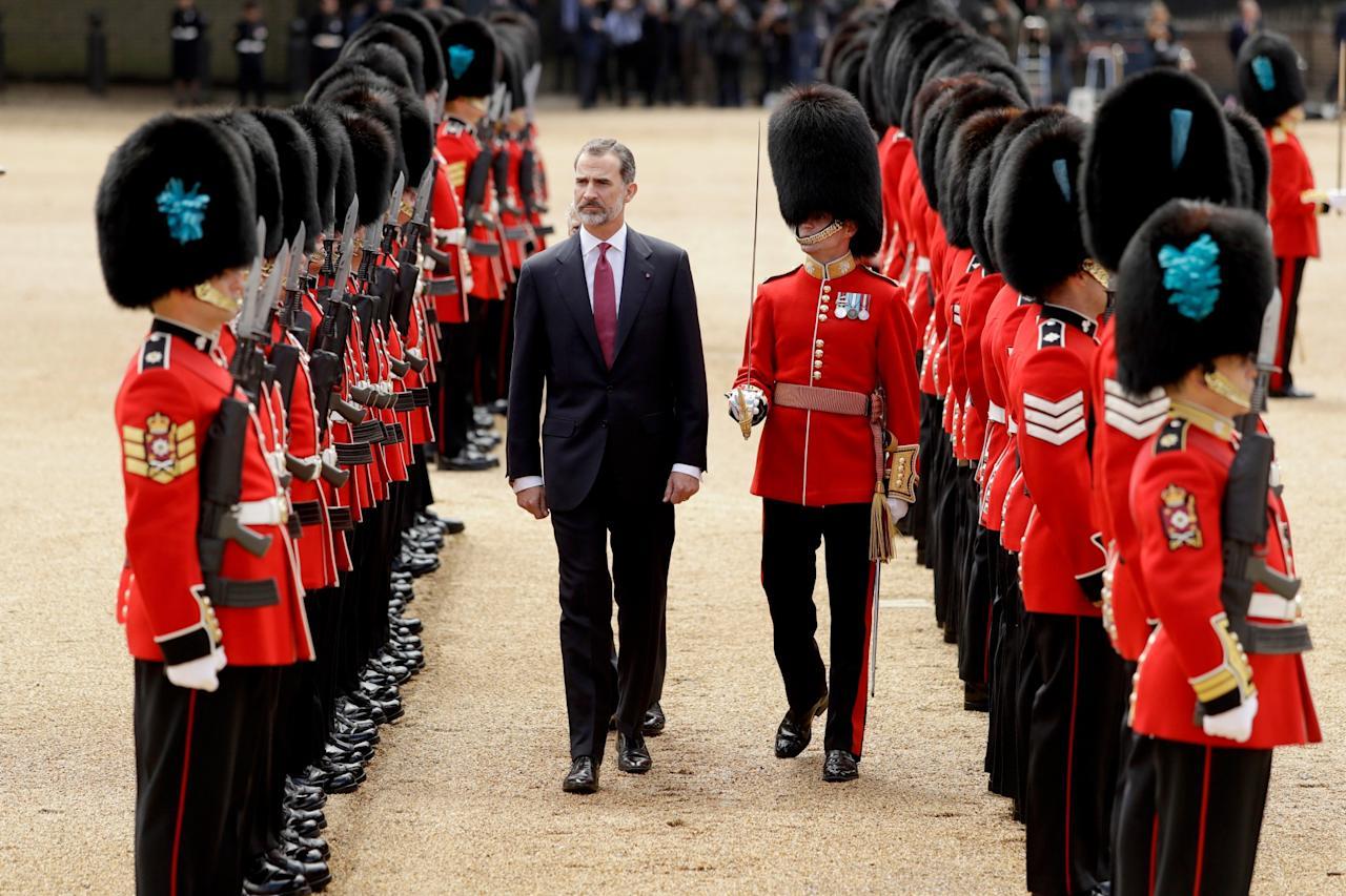 <p>King Felipe VI of Spain inspects a guard of honour during a Ceremonial Welcome on Horse Guards Parade in London (Getty Images) </p>