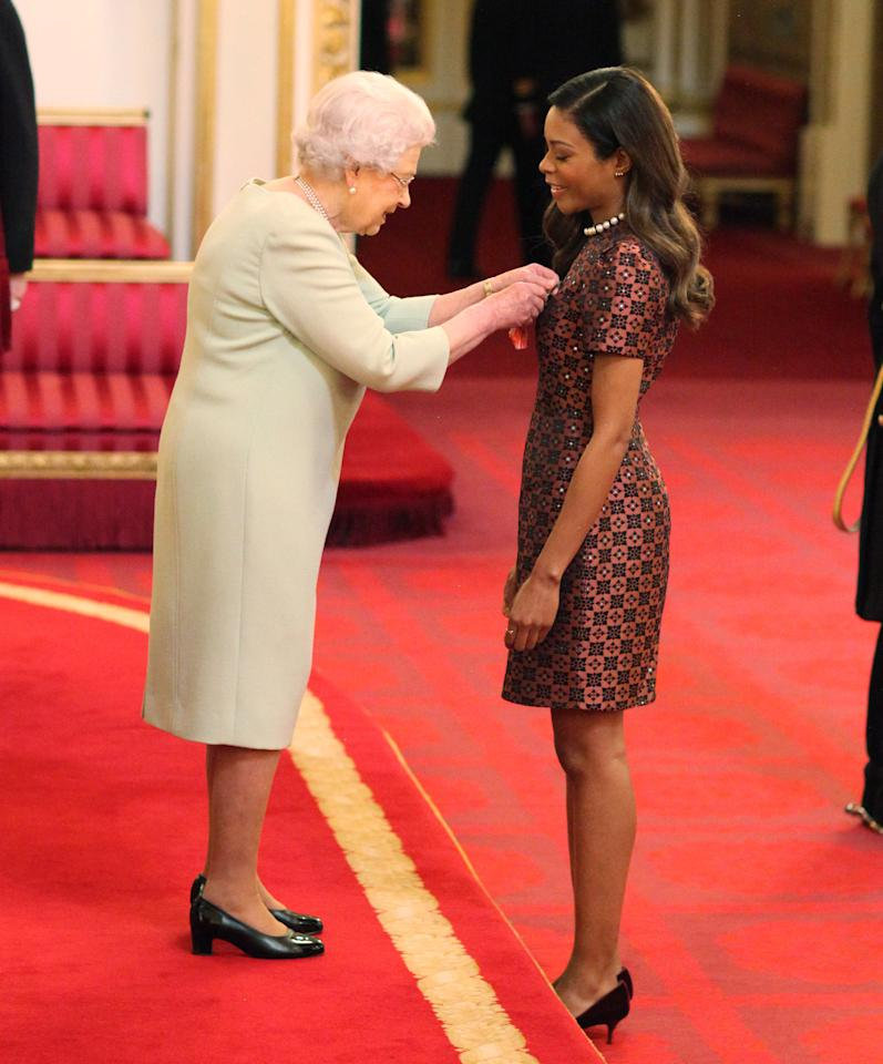 <p>The actress chose a ladylike midi dress fit for a princess to receive an OBE from the Queen back in 2017. <em>[Photo: Getty]</em> </p>
